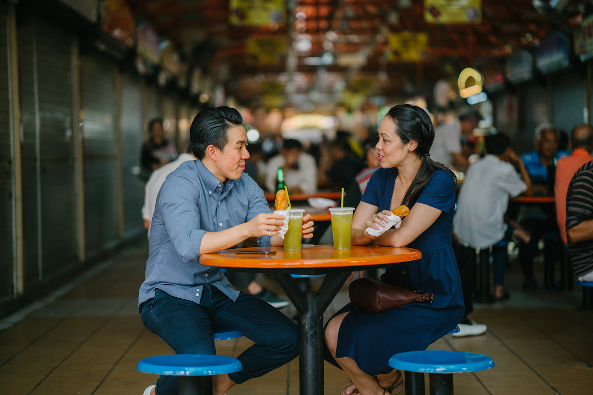 couple eating at a food street