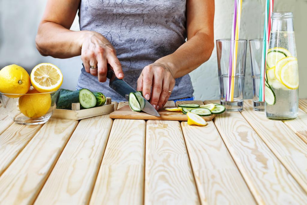 preparing cucumber lemon water