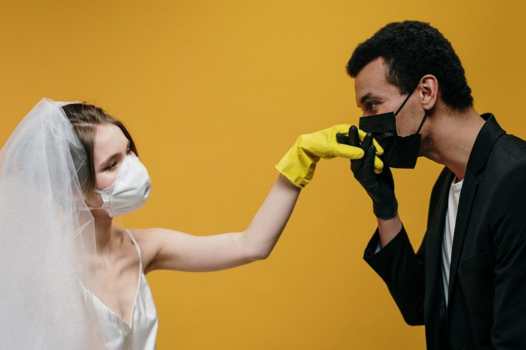 bride and groom wearing their masks