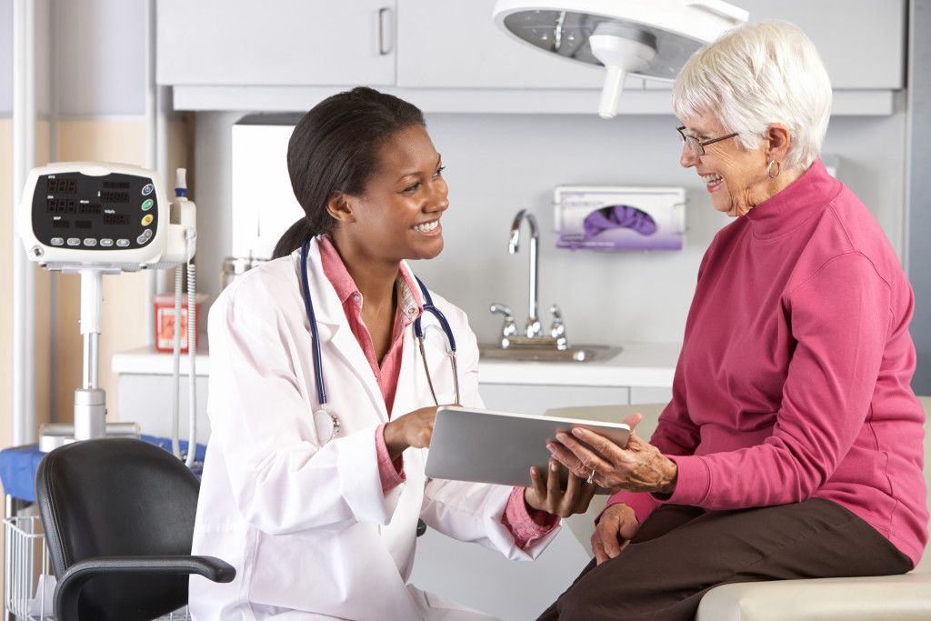 doctor talking to woman